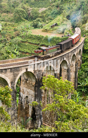 Vertical view of a train crossing the Nine Arches Bridge near Ella, Sri Lanka. - Stock Photo