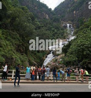 Square view of a people taking photos at Ravana Falls in Ella, Sri Lanka. - Stock Photo