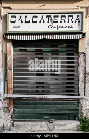 PALERMO-JUNE 10: an abandoned shop in the streets of the old town,Palermo,Italy,on June 10,2013. - Stock Photo