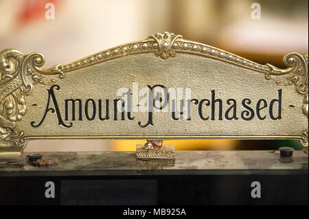 Amount purchased sign on old cash register. - Stock Photo
