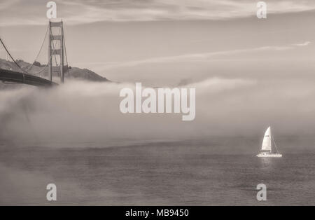 Fog formed under the Golden Gate Bridge and the San Francisco Bay, California, United States, on an early spring morning. - Stock Photo