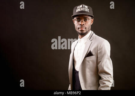 close up photo of rapper wearing formal clothing - Stock Photo