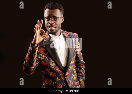 a handsome African young man showing okay gesture - Stock Photo