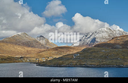 Looking across to the old whaling station at Bunavoneader on a sunny spring morning. Isle of Harris, Scotland. - Stock Photo