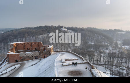 View to the ruins of The Keep Of The Upper Castle and Hill of Three Crosses from Gediminas Castle on frosty winter day - Stock Photo