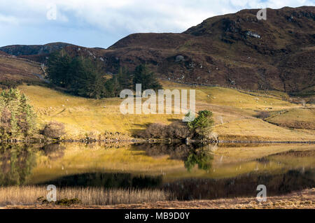 Fintown, County Donegal, Ireland,  Still reflections in Lough Finn. - Stock Photo