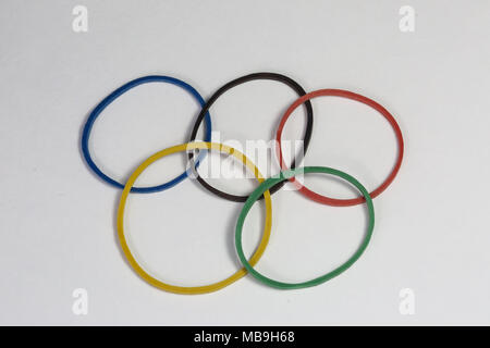 Coloured elastic bands representing the Olympic Symbol. Blue, Black, Red, Yellow and Green rings representing the five continents, united in Olympism. - Stock Photo