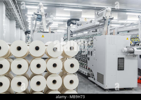 Machinery and equipment in the workshop for the production of thread. interior of industrial textile factory - Stock Photo