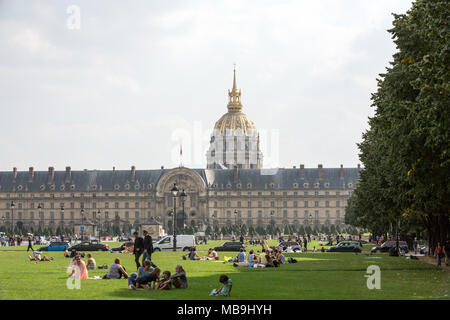 People resting in the park near main entrance Les Invalides. Paris, France - Stock Photo