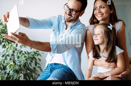 Happy family having fun time at home - Stock Photo