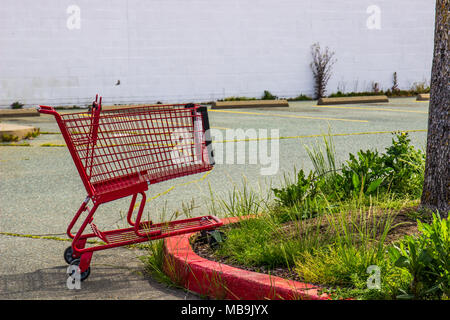 Lone Abandoned Shopping Cart In Closed Store Parking Lot - Stock Photo