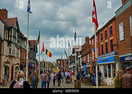 Stratford upon Avon street scene of Henley Street with tourists on WilliamShakespeares birthday. - Stock Photo