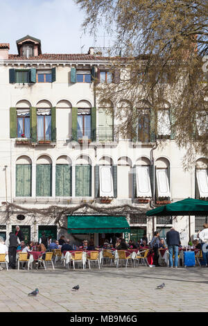 Campo San Polo, San Polo, Venice, Veneto, Italy in spring with locals and tourists eating outdoors at tables at the Pizzeria Bar Cico - Stock Photo