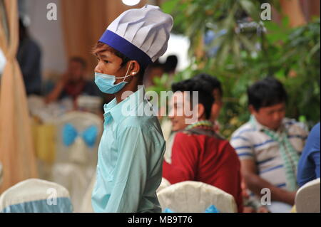 Phnom Penh, Cambodia. 8th April, 2018. Cambodia celebrates Khmer New Year while a young chef watches the festivities, Phnom Penh, Cambodia, Credit: Kraig Lieb / Alamy Live News - Stock Photo