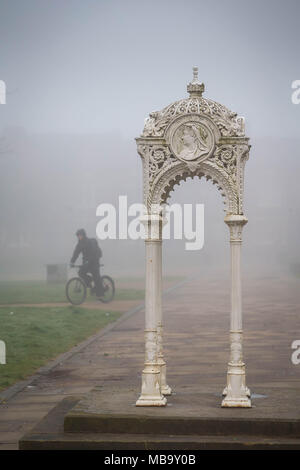Warrington, Cheshire, UK. 9th April, 2018. On a foggy Monday morning, 9th April 2018,  a cyclist rides through Queen's Gardens in Warrington, Cheshire, England, UK on his way to work Credit: John Hopkins/Alamy Live News - Stock Photo