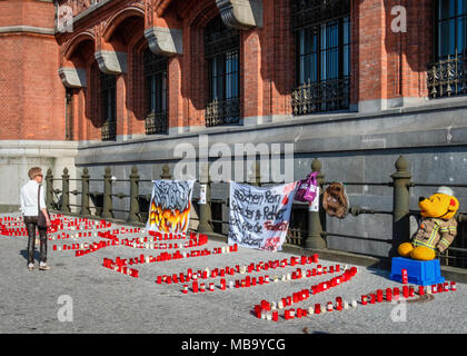 Germany Berlin, Mitte, 8th April 2018. Berlin Firefighters oppose austerity policies of state government in 'Berlin Burns' demonstration in Front of the Red Town Hall Firefighters are protesting about poor working conditions, lack of staff, old equipment and a recently introduced 12-hour shift system. A brazier carries their motto 'Berlin burns' in a symbolic attempt to alert the public to the dangerous situation. The firefighters' protest is directed against the Social Democratic-Left Party-Green Party coalition that runs the Berlin state government. credit: Eden Breitz/Alamy Live News - Stock Photo
