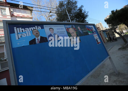 Election campaign posters promoting incumbent president Ilham Aliyev, presidential and other presidential candidates; Azerbaijan is to hold a presidential election 11 April 2018. Credit: Aziz Karimov/Alamy Live News - Stock Photo