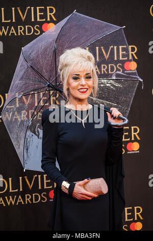 London, UK. 8th April, 2018. Tracie Bennett former Coronation Street Actress poses in the rain on the red carpet at the 2018 Olivier Awards held at the Royal Albert Hall. She was nominated for best actress in a supporting role for her performance in Follies Credit: David Betteridge/Alamy Live News - Stock Photo