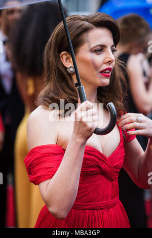 London, UK. 8th April, 2018. Ophelia Lovibond  actress poses in the rain on the red carpet at the 2018 Olivier Awards held at the Royal Albert Hall. Credit: David Betteridge/Alamy Live News - Stock Photo