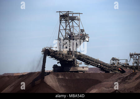 06 April 2018, Germany, Grevenbroich: A stacker of RWE Power transports soil at the surface mining Garzweiler in the Rhenish lignite mining region. Photo: Oliver Berg/dpa - Stock Photo