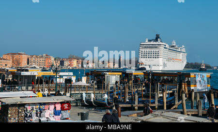 Cruise ship moving through Guidecca canal in Venice, Italy. Venice is situated across a group of 117 small islands that are separated by canals - Stock Photo