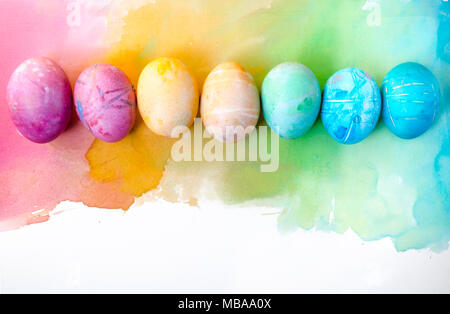 Watercolor background with colorful rainbow Easter eggs . Gentle, picturesque spring photocomposition. - Stock Photo