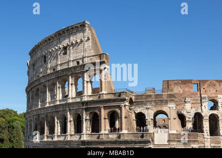 The Colosseum or Coliseum, also known as the Flavian Amphitheatre or Colosseo, is an oval amphitheatre, the largest in the world, in the centre of the - Stock Photo