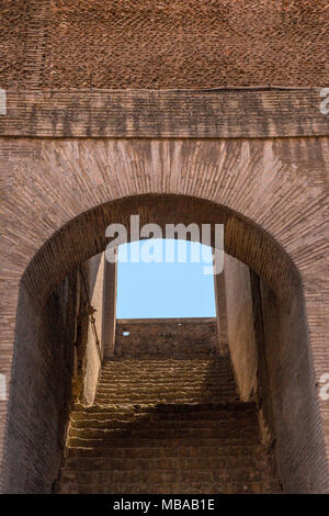 Intricate brickwork around entrance steps to one of the tiers in the Colosseum or Coliseum, also known as the Flavian Amphitheatre or Colosseo, is an  - Stock Photo