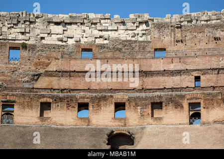 The upper walls of Colosseum or Coliseum, also known as the Flavian Amphitheatre or Colosseo, is an oval amphitheatre, the largest in the world, in th - Stock Photo