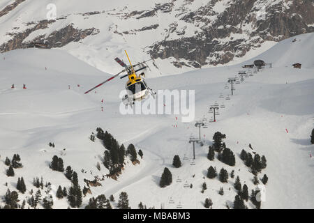 Helicopter Flying Over A Ski Resort Courchevel 3 Valleys Savoie Rhone Alpes France Europe - Stock Photo