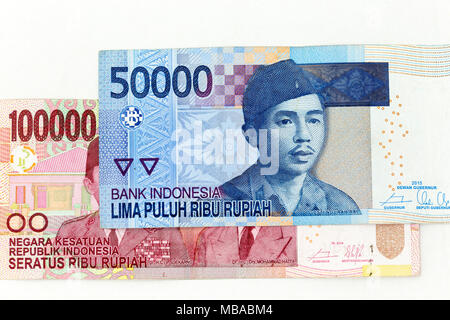 Currency banknotes spread across frame indonesian rupiah in various denomination - Stock Photo