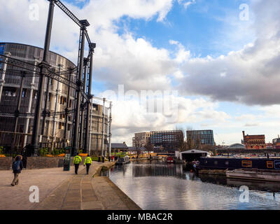 Cast-iron Victorian gasholders at King's Cross transormed into luxury homes in St Pancras Lock on Regent's Canal - London, England - Stock Photo