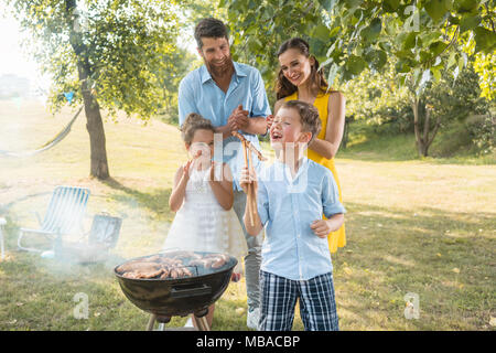 Portrait of happy family with two children outdoors - Stock Photo