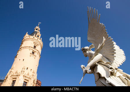 Schwerin, Germany. Statue of an angel and tower of Schwerin Castle Palace (Schweriner Schloss). A World Heritage Site in Mecklenburg-West Pomerania - Stock Photo