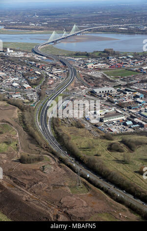 aerial view from the Widnes side of the River Mersey along the A562 towards the new Runcorn Bridge, Cheshire, UK - Stock Photo