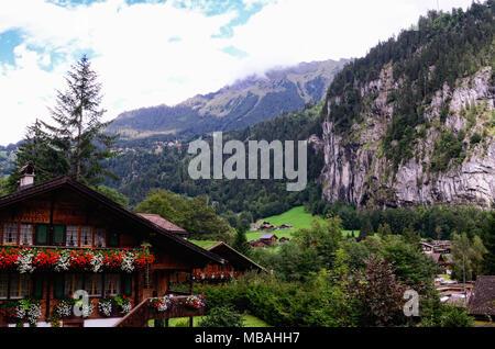 Swiss Alpine Tourist Town of Lauterbrunnen in Lauterbrunnen Valley, Jungfrau Region, Canton of Bern, Switzerland. View from the South. - Stock Photo