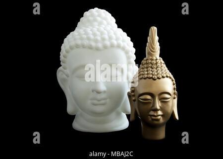 One white boeddha and one gold boeddha isolated over black - Stock Photo