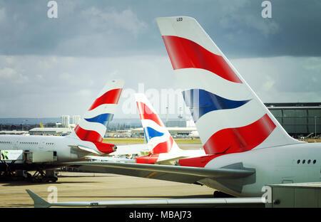 British Airways planes - tailplanes at Heathrow Airport, T5, London UK - Stock Photo
