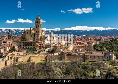 City skyline with the Gothic Cathedral and the snowy mountains of Sierra de Guadarrama in the background, Segovia, Castile and Leon, Spain - Stock Photo