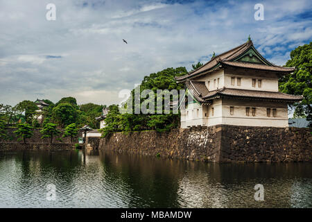 View of Tokyo Imperial Palace gardens ancient walls, fortified gate and moat - Stock Photo