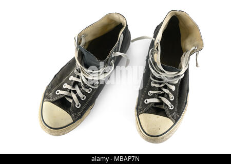 Old sport sneakers isolated on white background. Top view. - Stock Photo