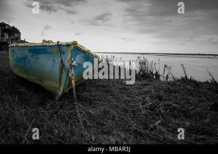Blue boat on the estuary at Saint Valery-Sur-Sommebaie de somme - Stock Photo