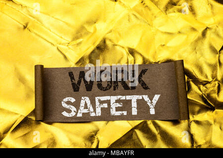 Handwriting text writing Work Safety. Concept meaning Caution Security Regulations Protection Assurance Safeness written Cardboard Piece the Golden te - Stock Photo