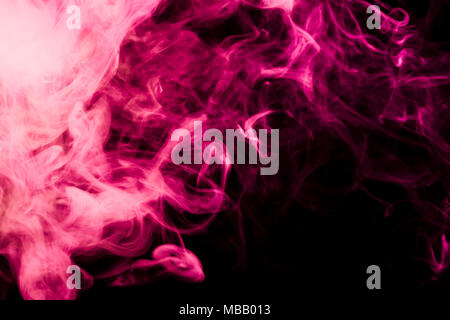 Colorful  blue smoke  on a black isolated background. Background from the smoke of vape - Stock Photo