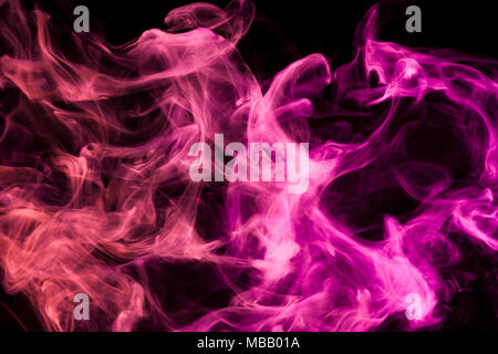 Colorful pink and red smoke  on a black isolated background. Background from the smoke of vape - Stock Photo