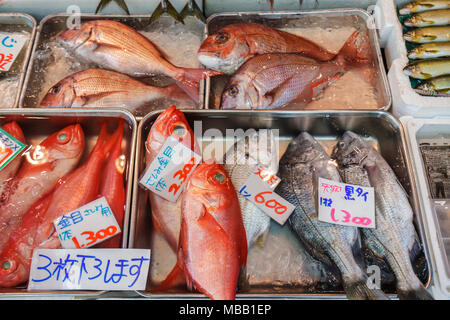 Tokyo Japan Tsukiji Fish Market shopping kanji hiragana characters for sale display fresh vendor - Stock Photo