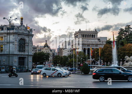 Madrid, Spain - November 3, 2017:  View of Cybele Square, Alcala Street and Bank of Spain building. The plaza is a landmark and it is famous for the f - Stock Photo