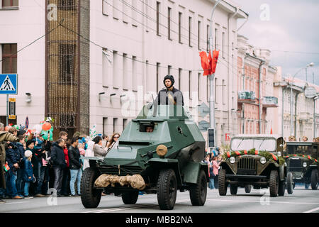 Gomel, Belarus - May 9, 2017: Armoured Soviet Scout Car Ba-64 With Re-enactor Dressed As Russian Soviet Crew Member Of World War Ii Taking Part In Par - Stock Photo