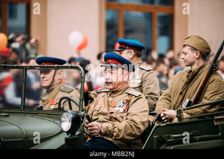 Gomel, Belarus - May 9, 2017: People Uniformed Soviet Soldiers And Officers Involved In Parade Dedicated To Victory Day On Vehicles Of World War II. - Stock Photo