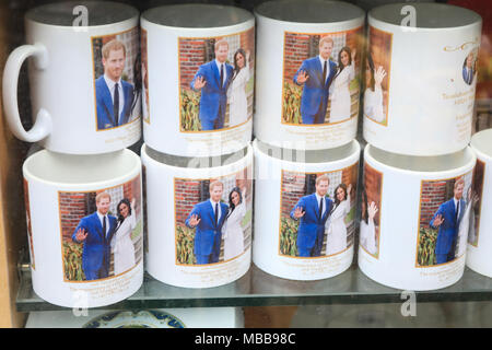 London UK. 10th April 2018. A Souvenir shop in central London Royal Wedding memorabilia with the portraits of HRH Prince Harry and his fiancee Meghan Markle featured on souvenr flags and mugs before the royal marriage at Windsor Castle   on 19th May 2018 Credit: amer ghazzal/Alamy Live News - Stock Photo